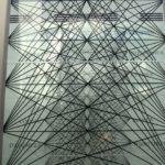 View through two glass panels in atrium, photo Phyllis Bretholz