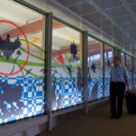 detail 800 foot glass corridor for the International Arrivals Terminal C