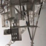 detail of improvised housing colony around satellite tower